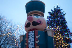 This image shows Christmas lights and a nutcracker at Rice Park
